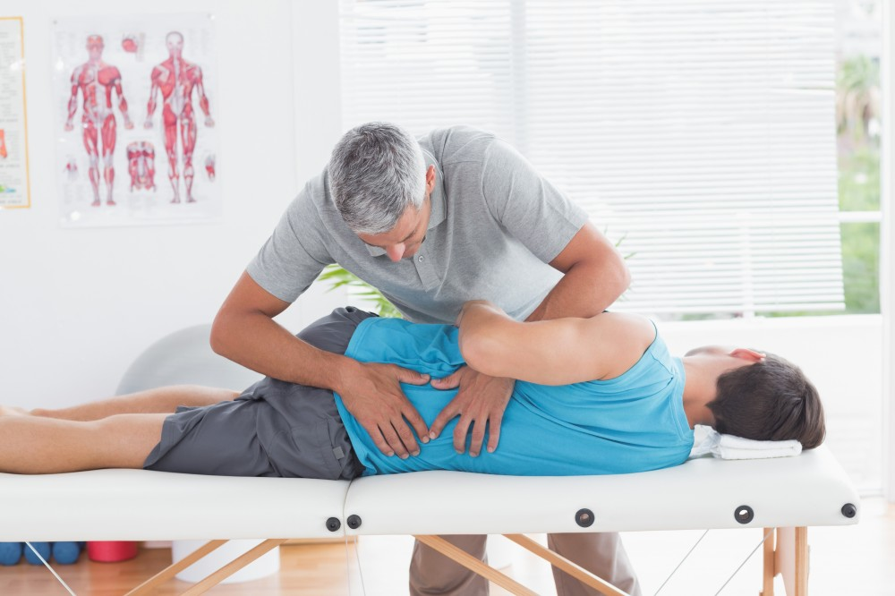 physiotherapist treating sciatica